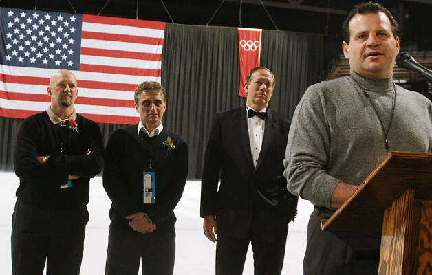 "Mike Eruzione, right, captain of the1980 U.S. Olympic hockey team, speaks to attendees of a reception Thursday, Feb. 5, 2004, at the Olympic Center in Lake Placid, N.Y., prior to a screening of the film ""Miracle."" Also on the ice are 1980 Olympic hockey team members Jack O'Callahan, left, and Buzz Schneider along with New York Gov. George Pataki. Photo: TODD BISSONETTE, AP / AP"