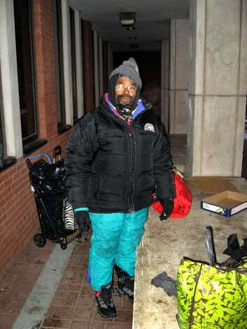 Eugene Johnson, who's been homeless for four years, spends his nights behind the Fairfield County Courthouse on Main Street in Bridgeport. He stays away from shelters because, he says, they have too much crime. Photo: John Burgeson / Connecticut Post