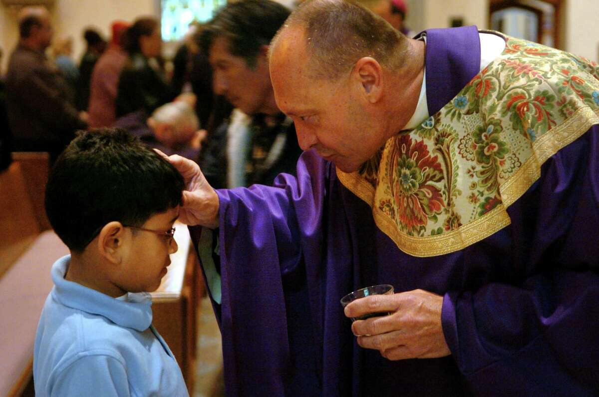 During the noontime Ash Wednesday mass at St. Augustine's Cathedral in Bridgeport, Conn. on Feb. 6th, 2008, Monsignor Kevin Wallin, Pastor at St. Augustine's, distributed ashes to the students of St. Augustine School.