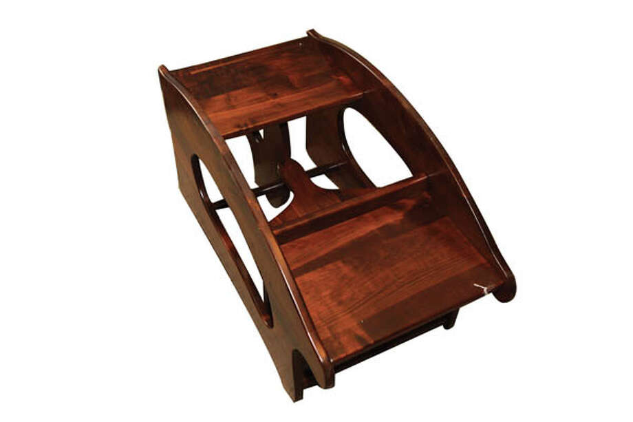 """3 in 1""Talk about multi-use: This piece is a booster seat, a child's desk, and a rocking horse all in one. Shown in maple, also available in oak. Measures 32 x 16. $205 at Blue Hen."