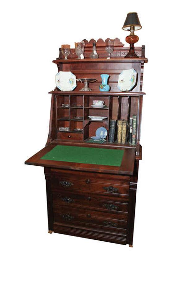 Plantation DeskWalnut Victorian drop front plantation desk measures 65x30x17. $795 at Black Sheep Antique Center.