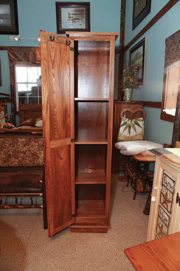 360˚ Rotating Bedroom StorageThis unique elm wood storage system rotates on its base. Features a mirror on one side, clothes hooks on two sides and a storage cabinet around back with adjustable shelves and small accessory hooks inside the door. 72 tall, 15 square. $695. Find it at Blue Hen.