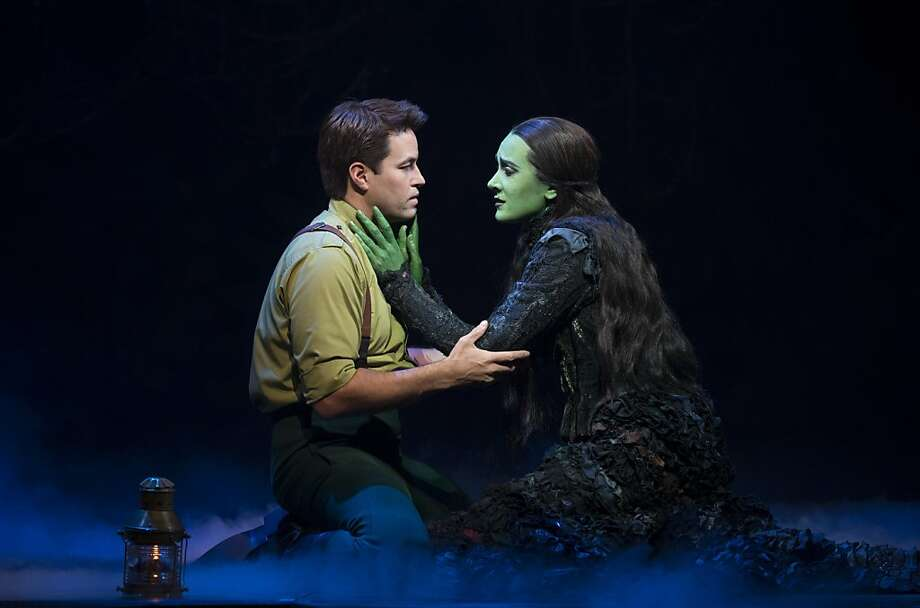 "Fiyero (Cliffton Hall) and Elphaba (Dee Roscioli) can feel the spell that love has cast on them in ""Wicked."" Photo: Joan Marcus"