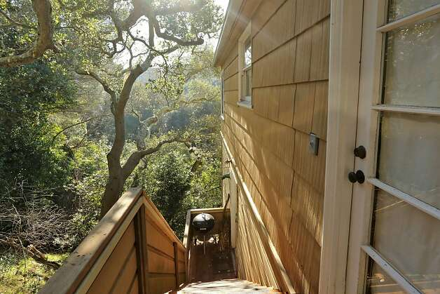 Exterior steps lead to the home's middle level. Photo: Liz Rusby