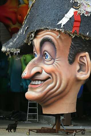 Bring me the head of … A cat investigates the giant noggin of former French President Nicolas Sarkozy at the Cittadella del Carnevale in Viareggio, Italy. The effigy, used in last year's carnival parade, is already showing signs of tattering. Photo: Fabio Muzzi, AFP/Getty Images