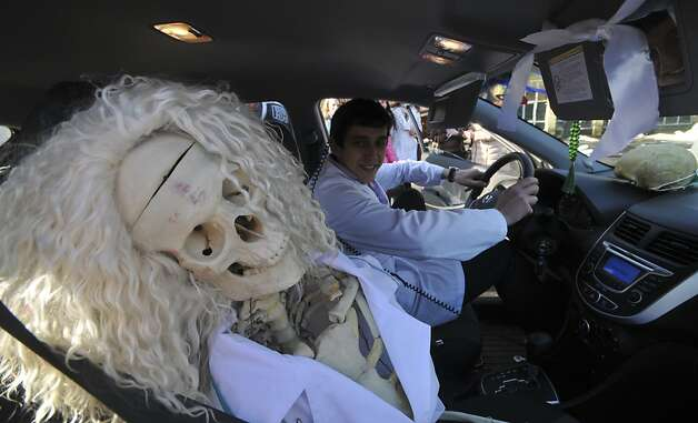 Seat belt on? A medical student takes friend from work to a carnival celebration marking Students Day in the Russian city of Stavropol. Photo: Danil Semyonov, AFP/Getty Images