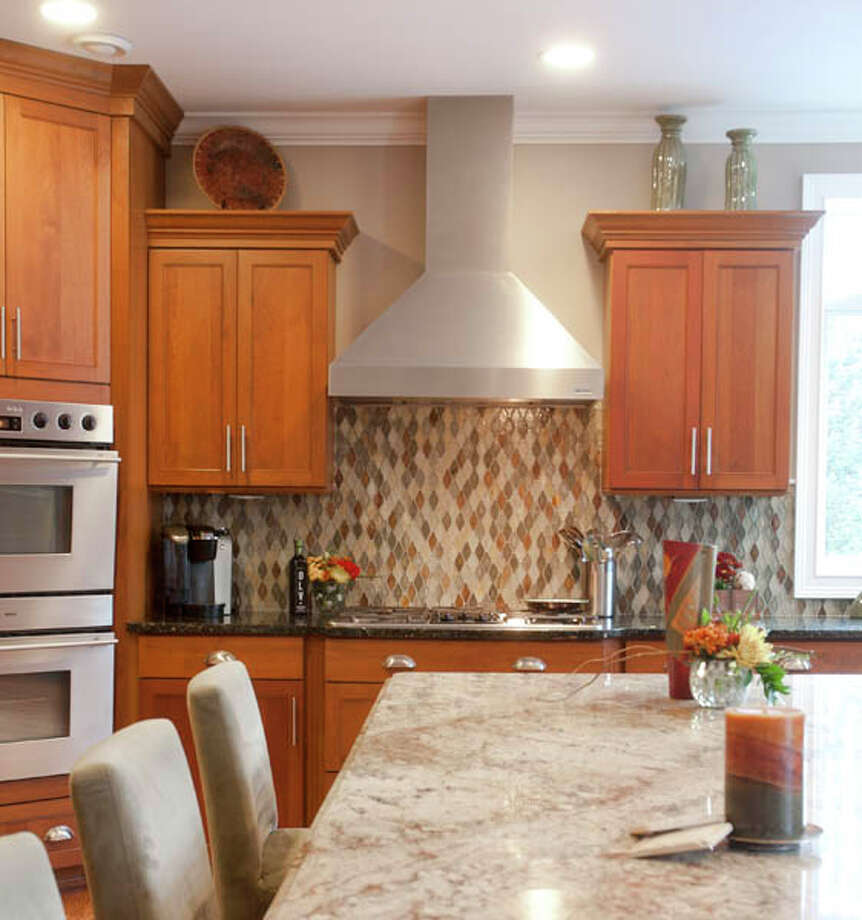 This backsplash was custom-done, assembled and installed by hand.