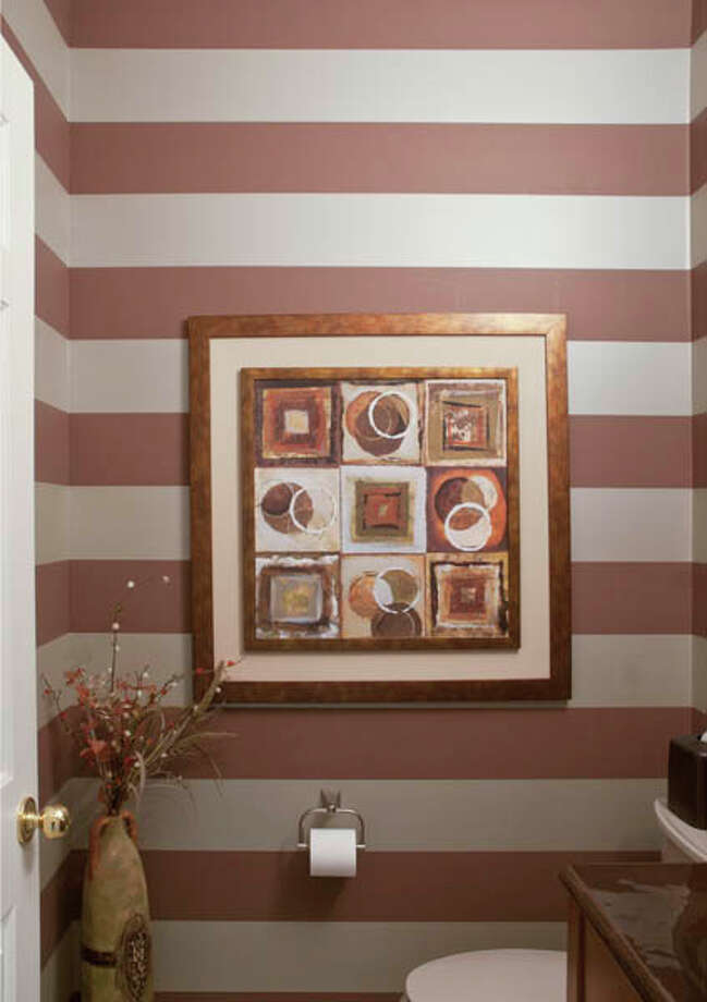 Neat idea: Instead of one solid color, paint a wall with horizontal stripes!