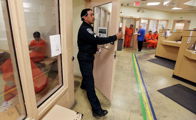 Cpl. Louis Reyna checks on inmates Thursday Jan. 24, 2013 at the Bexar County Jail. Photo: Edward A. Ornelas, San Antonio Express-News / © 2013 San Antonio Express-News