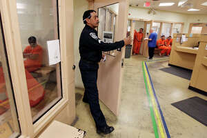 Cpl. Louis Reyna checks on inmates Thursday Jan. 24, 2013 at the Bexar County Jail.
