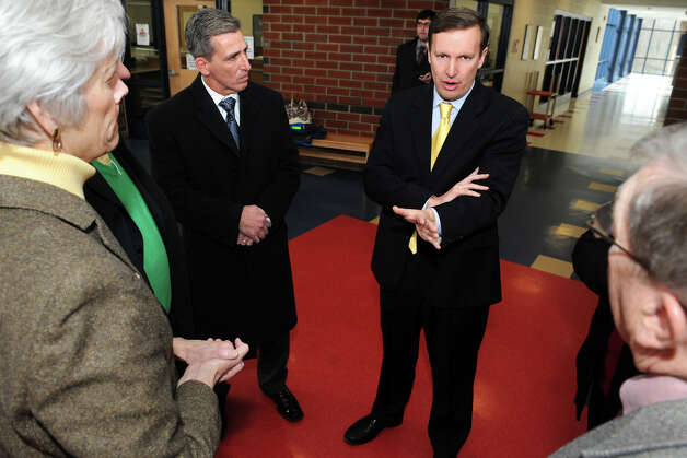 Senator Chris Murphy speaks with city and school officials during a tour of Foran High School, in Milford, Conn., Jan. 25th, 2013. Photo: Ned Gerard / Connecticut Post