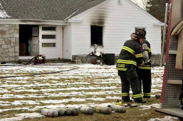 Firefighters were called to a house fire at 6 Dogwood Drive in Danbury on Friday, Jan. 25, 2013. Photo: Jason Rearick / The News-Times