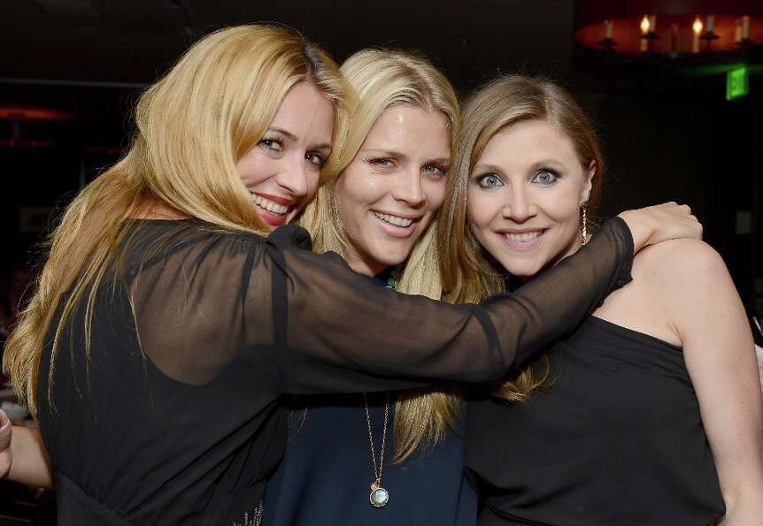 (L-R) TV personality Cat Deeley and actresses Busy Philipps and Sarah Chalke attend the ELLE's Women