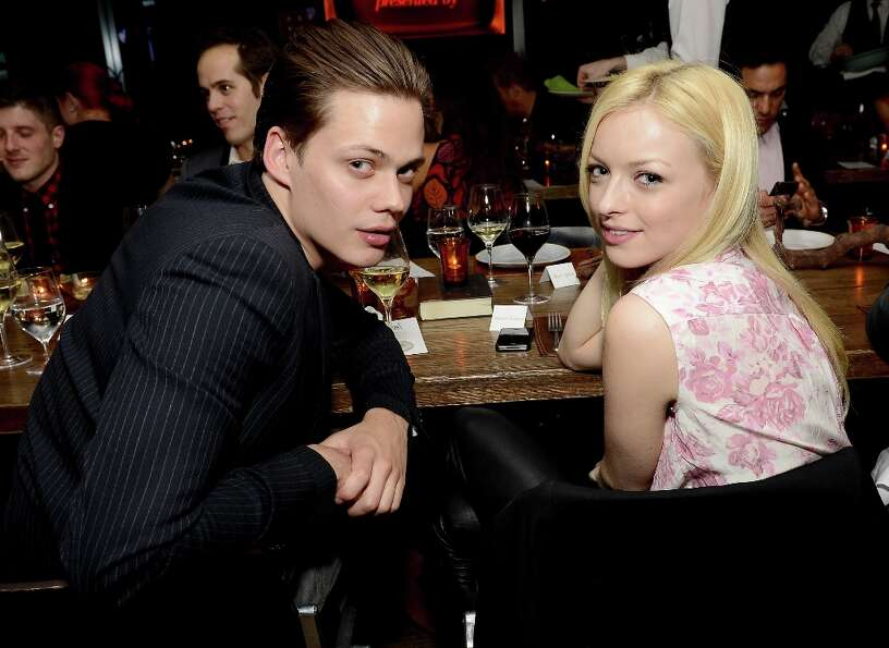 Actors Bill Skarsgard (L) and Francesca Eastwood attend the ELLE's Women in Television Celebration a
