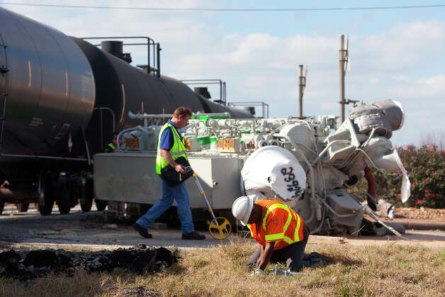Crews work to clean up a wreck after an 18-wheeler collided with a train at the HWY 290 frontage road and Tegle Road Friday, Jan. 25, 2013, in Cypress. Photo: Cody Duty, Houston Chronicle / © 2013 Houston Chronicle