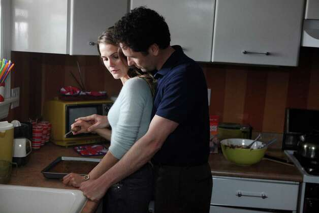 Elizabeth and Phillip Jennings (Keri Russell and Matthew Rhys) are far from your typical husband and wife in FX's new drama about a pair of KGB spies who go undercover in the Reagan era. Photo: FX