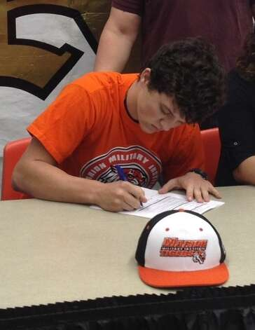 Nederland baseball player Gabriel Nevala signed with Marion Military Institute on Thursday, Jan. 24, 2013. Photo: Courtesy Of Gabriel Nevala