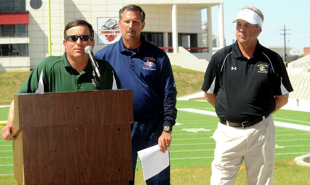 East Chambers coach, Tony Valastro, SETX Coaches Association's David Martel, and Nederland coach, Larry Neumann answer questions during a press conference to announce the East and West coaches of The Classic at the Provost-Umphrey Stadium in Beaumont, Tuesday. Tammy McKinley/The Enterprise Photo: TAMMY MCKINLEY / Beaumont