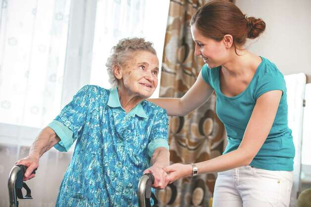 Senior woman with her caregiver at home Photo: Alexander Raths / Alexander Raths - Fotolia