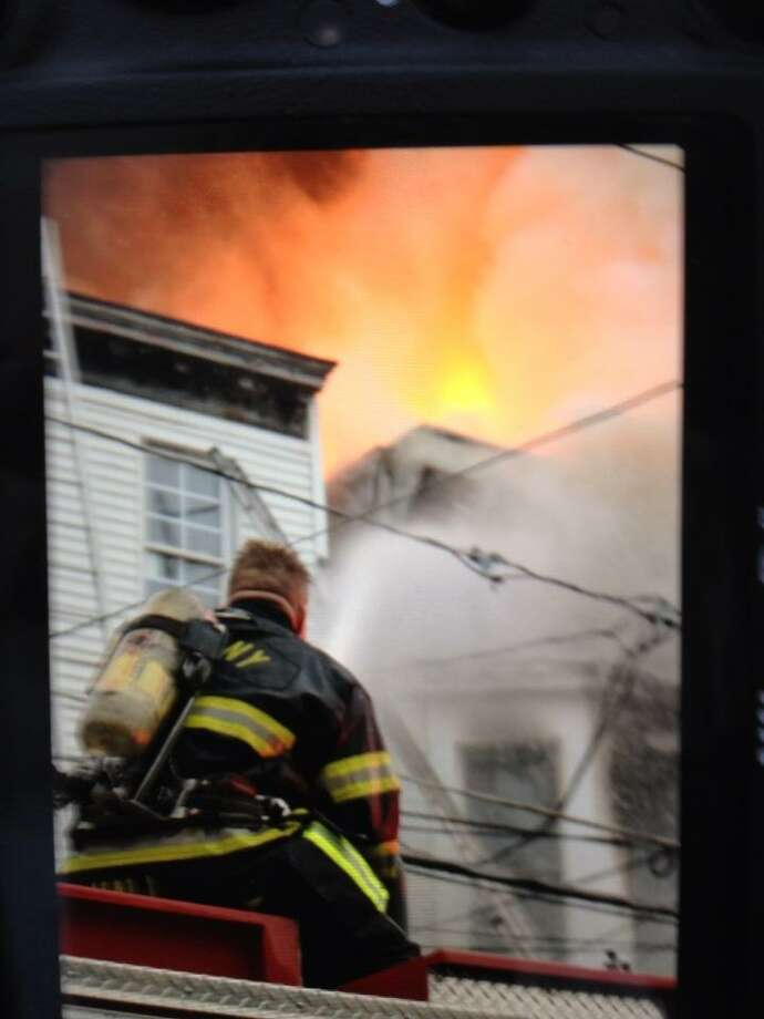 Albany firefighters battle a blaze at 159 Dove St. on Friday, Jan. 25, 2013. (John Carl D'Annibale)