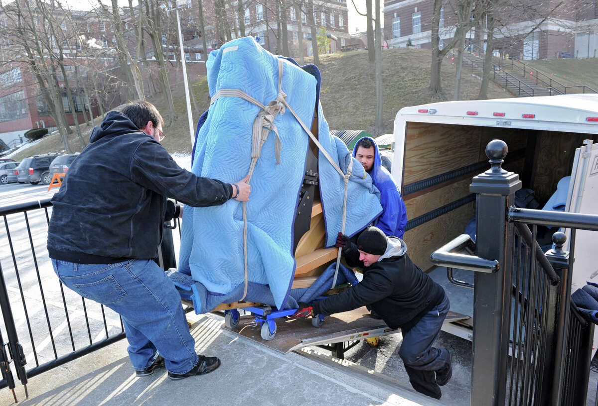 Movers David King, left, Sean King, bottom, and Alvin Davis of King Piano Moving Company deliver five Steinway pianos to RPI's School of Humanities Arts, and Social Sciences (HASS) on Friday Jan. 25, 2013 in Troy, N.Y. (Lori Van Buren / Times Union)