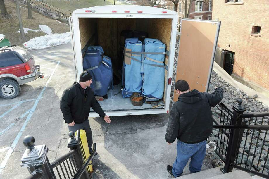 Movers Sean King, left, and David King of King Piano Moving Company open the back of the truck as RPI's School of Humanities Arts, and Social Sciences (HASS) receives a delivery of five Steinway pianos on Friday Jan. 25, 2013 in Troy, N.Y.  (Lori Van Buren / Times Union) Photo: Lori Van Buren