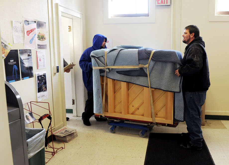 Movers Alvin Davis, left, and David King of King Piano Moving Company deliver five Steinway pianos to RPI's School of Humanities Arts, and Social Sciences (HASS) on Friday Jan. 25, 2013 in Troy, N.Y.  (Lori Van Buren / Times Union) Photo: Lori Van Buren