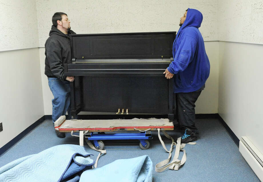 Movers David King, left, and Alvin Davis of King Piano Moving Company deliver five Steinway pianos to RPI's School of Humanities Arts, and Social Sciences (HASS) on Friday Jan. 25, 2013 in Troy, N.Y.  (Lori Van Buren / Times Union) Photo: Lori Van Buren