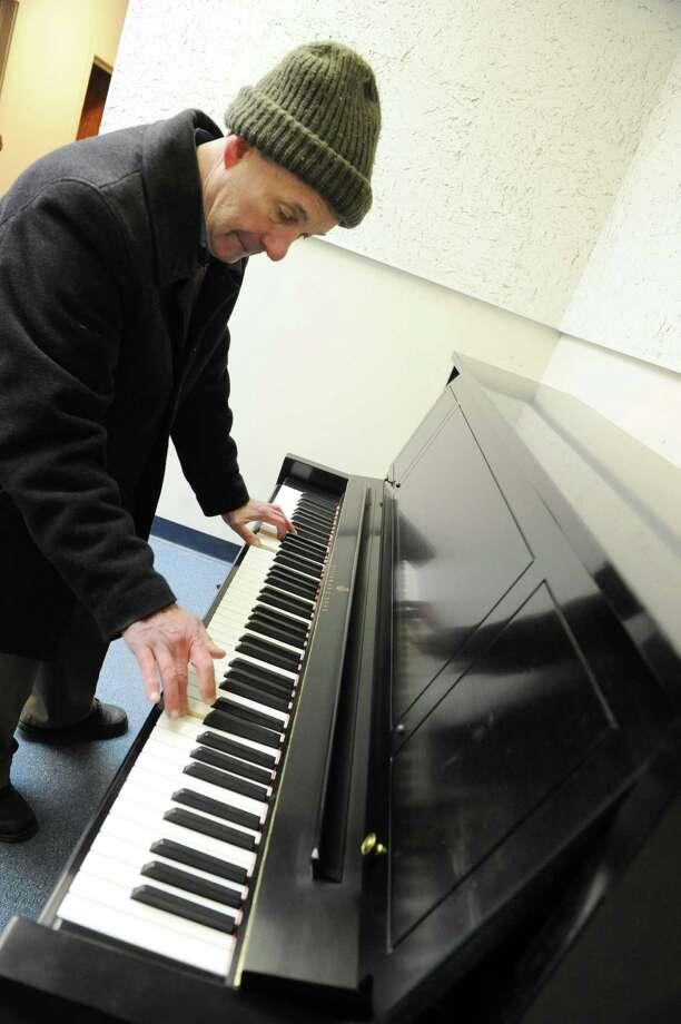 Rick Rowley of Clark Music in Clifton Park tries out a piano as RPI's School of Humanities Arts, and Social Sciences (HASS) receives a delivery of five Steinway pianos on Friday Jan. 25, 2013 in Troy, N.Y.  (Lori Van Buren / Times Union) Photo: Lori Van Buren