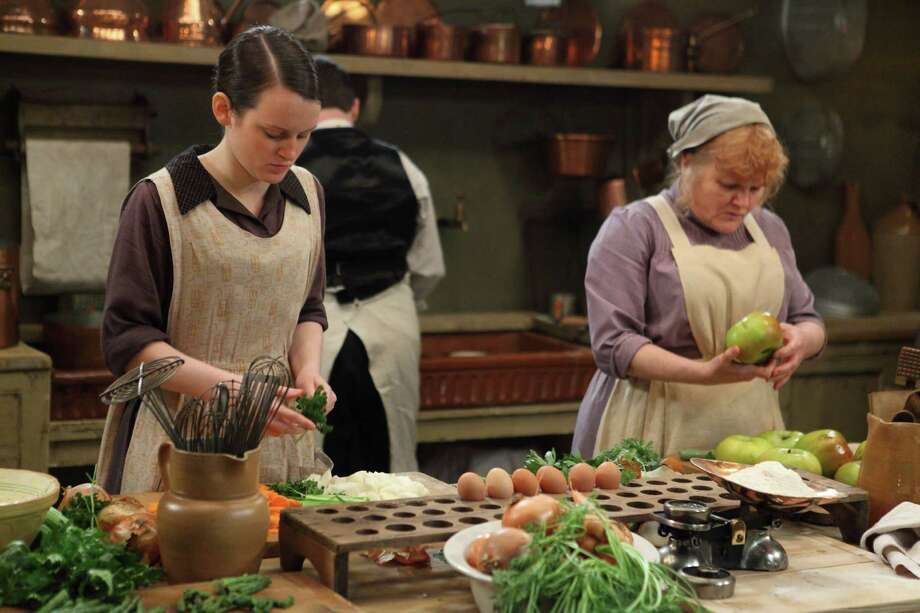 Kitchenmaid Daisy Mason (Sophie McShera), left, assists the cook, Mrs. Patmore (Lesley Nicol), in the Downton Abbey kitchen. The popular PBS drama has spurred interest in British food of the early 20th century. Photo: --