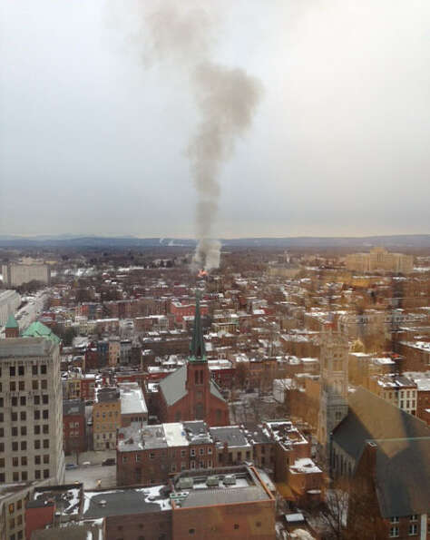 Smoke rises from the 2 alarm fire at 159 Dove Street Friday afternoon in Albany, N.Y. (Reader submit