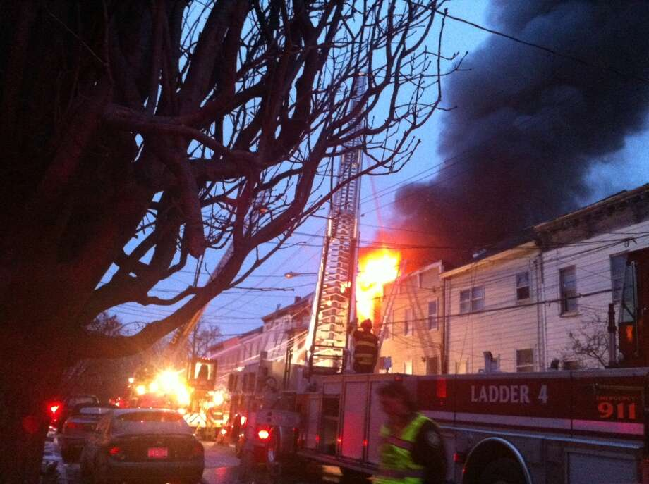 Albany firefighters work to put out the flames on a fire at 159 Dove St. and a neighboring home on Friday, Jan. 25, 2013. (Kristen V. Brown/Times Union)