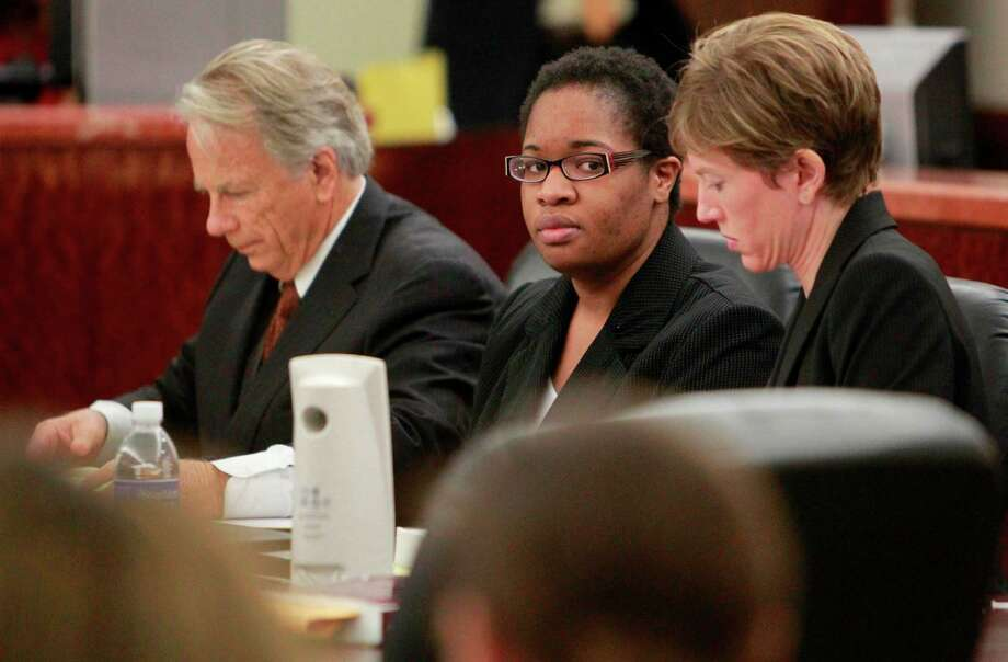 Attorney Mike DeGeurin and Jessica Tata, 22, during her July 2011 hearing in the 180th State District Court in the Harris County Criminal Courthouse where she was denied a lower bond. Photo: Houston Chronicle