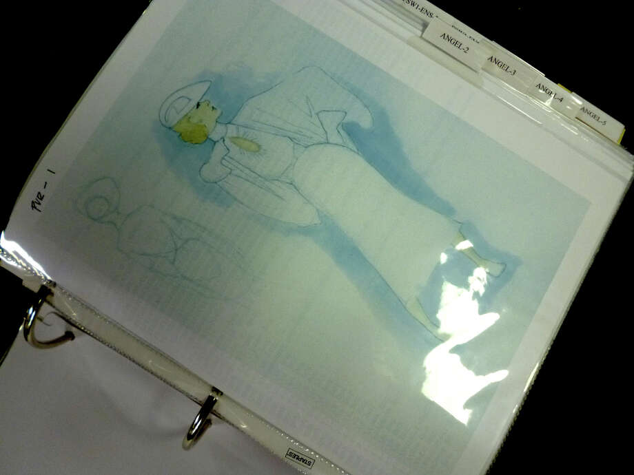 The design book contains costume sketches and fabric swatches.