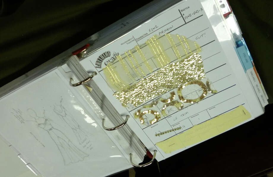 The Anything Goes design book contains costume sketches and fabric swatches.