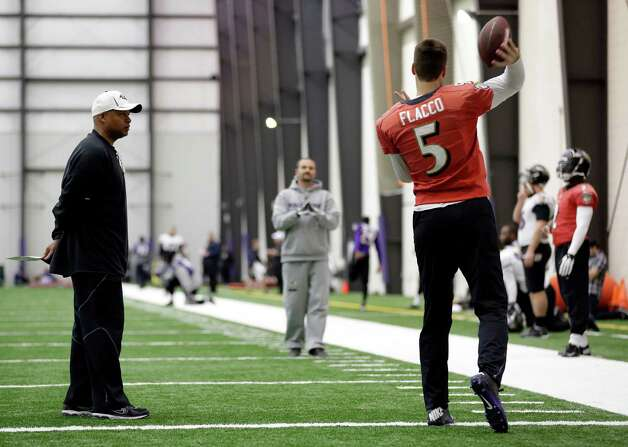 Baltimore Ravens offensive coordinator Jim Caldwell, left, looks on as quarterback Joe Flacco (5) warms up during a practice session at the team's practice facility in Owings Mills, Md., Thursday, Jan. 24, 2013. The Ravens are scheduled to face the San Francisco 49ers in Super Bowl XLVII in New Orleans on Sunday, Feb. 3. (AP Photo/Patrick Semansky) Photo: Patrick Semansky, Associated Press / AP