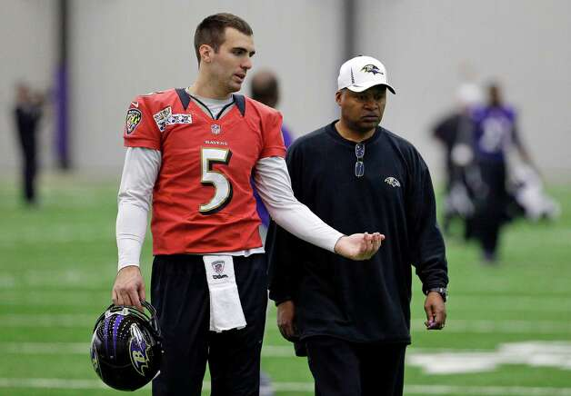 Baltimore Ravens quarterback Joe Flacco, left, speaks with offensive coordinator Jim Caldwell after NFL football practice at the team's training facility in Owings Mills, Md., Friday, Jan. 25, 2013. The Ravens are scheduled to face the San Francisco 49ers in Super Bowl XLVII in New Orleans on Sunday, Feb. 3. (AP Photo/Patrick Semansky) Photo: Patrick Semansky, Associated Press / AP