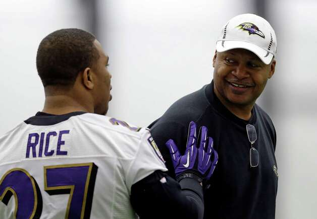 Baltimore Ravens offensive coordinator Jim Caldwell, right, chats with running back Ray Rice during a practice at the team's practice facility in Owings Mills, Md., Wednesday, Jan. 16, 2013. The Ravens are scheduled to face the New England Patriots in the AFC Championship on Sunday. (AP Photo/Patrick Semansky) Photo: Patrick Semansky, Associated Press / AP