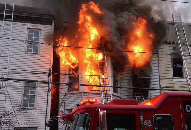 Flames rip through 159 Dove Street in Albany Friday Jan. 25, 2013.  (John Carl D'Annibale / Times Union) Photo: John Carl D'Annibale