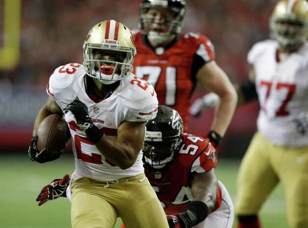San Francisco 49ers' LaMichael James (23) gets away from Atlanta Falcons' Stephen Nicholas (54) for a 15-yard touchdown run during the first half of the NFL football NFC Championship game Sunday, Jan. 20, 2013, in Atlanta. (AP Photo/David Goldman) Photo: David Goldman, Associated Press / AP
