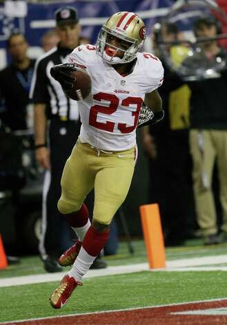 San Francisco 49ers' LaMichael James celebrates after rushing 15-yards for a touchdown during the first half of the NFL football NFC Championship game against the Atlanta Falcons Sunday, Jan. 20, 2013, in Atlanta. (AP Photo/Dave Martin) Photo: Dave Martin, Associated Press / AP