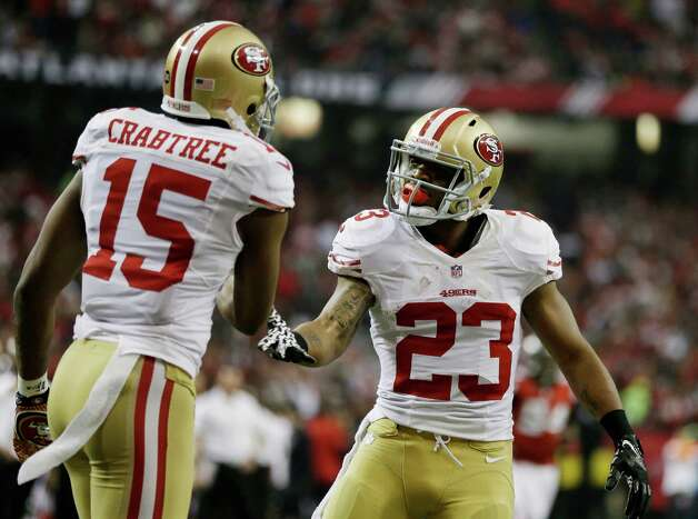 San Francisco 49ers' LaMichael James celebrates his touchdown run with teammate Michael Crabtree (15) during the first half of the NFL football NFC Championship game against the Atlanta Falcons Sunday, Jan. 20, 2013, in Atlanta. (AP Photo/David Goldman) Photo: David Goldman, Associated Press / AP
