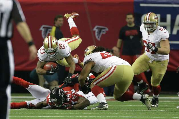 San Francisco 49ers' LaMichael James is tackled during a kickoff return during the first half of the NFL football NFC Championship game against the Atlanta Falcons Sunday, Jan. 20, 2013, in Atlanta. (AP Photo/Mark Humphrey) Photo: Mark Humphrey, Associated Press / AP