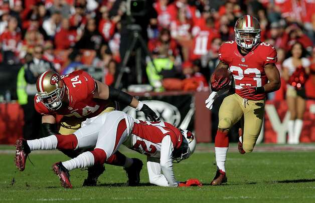 San Francisco 49ers running back LaMichael James (23) runs as offensive tackle Joe Staley (74) blocks Arizona Cardinals cornerback William Gay (22) during the second quarter of an NFL football game in San Francisco, Sunday, Dec. 30, 2012. (AP Photo/Marcio Jose Sanchez) Photo: Marcio Jose Sanchez, Associated Press / AP