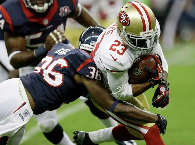 Houston Texans' Alan Ball (36) grabs San Francisco 49ers' LaMichael James (23) in the first quarter an NFL preseason football game Saturday, Aug. 18, 2012, in Houston. (AP Photo/David J. Phillip) Photo: David J. Phillip, Associated Press / AP