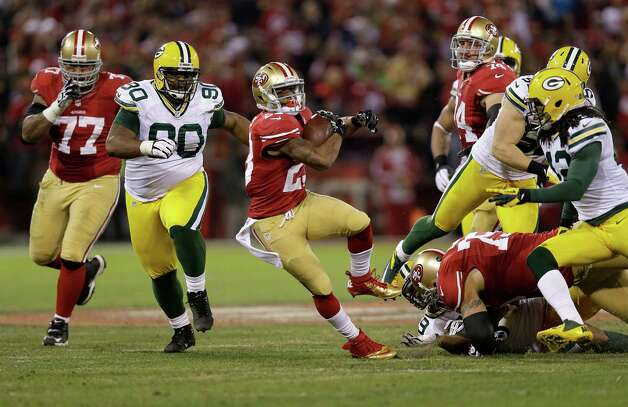 San Francisco 49ers running back LaMichael James (23) runs against Green Bay Packers nose tackle B.J. Raji (90) and strong safety Morgan Burnett (42) during the second quarter of an NFC divisional playoff NFL football game in San Francisco, Saturday, Jan. 12, 2013. (AP Photo/Marcio Jose Sanchez) Photo: Marcio Jose Sanchez, Associated Press / AP