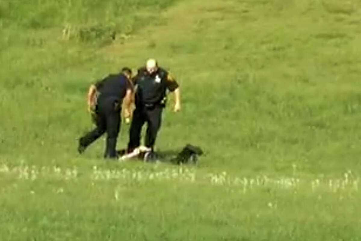 A screen grab from a video, posted on YouTube on Jan. 6, 2013, showing three Bridgeport, Conn. police officers kicking a man in Beardsley Park on May 20, 2011. Officers Elson Morales, Joseph Lawlor and Clive Higgins were put on the paid administrative leave Jan.18, 2013 pending an investigation of the incident by the cityâÄôs Office of Internal Affairs. The man, who has not been identified, is lying on the ground after being Tasered by one of the officers when two of the officers begin kicking him. A third officer then gets out of his patrol car and walks over to where the other two are still kicking the man and then he too begins kicking him.