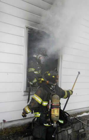 Firefighters were called to a house fire at 6 Dogwood Drive in Danbury on Friday, Jan. 25, 2013. Photo: Contributed Photo / The News-Times Contributed