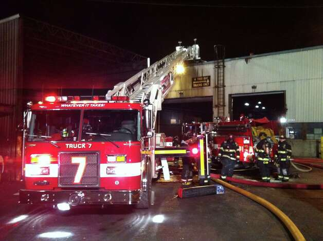 Firefighters battle a blaze at Ansonia Copper and Brass in Ansonia, Conn. that broke out about 5 p.m. on Friday Jan. 25, 2013. Photo: Ned Gerard / Connecticut Post
