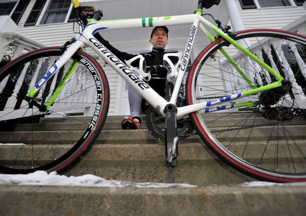 "Sandy Hook resident Monte Frank is an organizer and one of 26 bicycle riders in the Sandy Hook Ride on Washington that will be cycling from Sandy Hook Elementary School to Washington, D.C., on March 9 in support of what the organization's Facebook page called ""common sense gun safety legislation."" Photographed in front of his home in Newtown on Friday, Jan. 25, 2013. Photo: Jason Rearick / The News-Times"